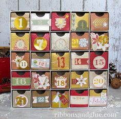 DIY Metallic Advent Calendar made from the Pink Paislee Snow Village collection Christmas Countdown, Christmas Time, Christmas Ideas, Christmas Calendar, Christmas Projects, Family Christmas, Christmas Ornament, Holiday Ideas, Vintage Christmas