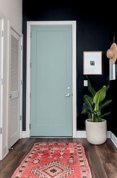 A minimal modern entryway makeover - bringing personality to a standard apartment with paint.