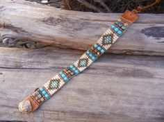 Like this one. Check out black one on the site. Beaded loomed wrap bracelet with by UnderWrapsBoutique on Etsy, $55.00: