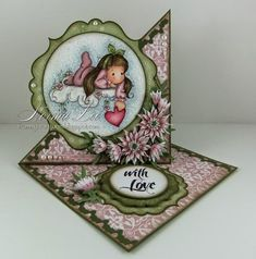 A twisted easel card featuring 'Tilda With Dot Bow' and 'Flower Cloud.'