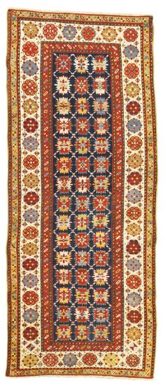 A Lesghi long rug, Northeast Caucasus approximately 8ft. 6in. by 4ft. 4in. (2.59 by 1.32m.) circa 1880