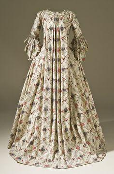 Woman's Robe à la Française, circa 1770  Costume/clothing principle attire/entire body, Cotton plain weave, block-printed and dye-painted, with silk passementerie, Center back length: 61 in. (154.94 cm)