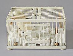 """Rose Sélavy figures allusively in this """"semi-Readymade,"""" which consists of a small metal cage containing marble cubes and a thermometer. Duchamp explained that the thermometer was to register the coldness of the marble cubes since it is the cold that causes sneezes."""
