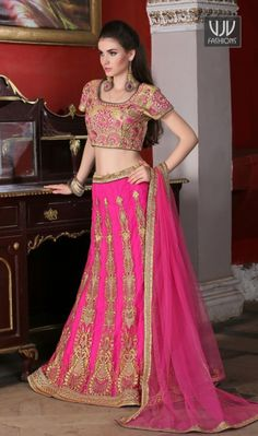 Preferable Embroidered Work Hot Pink A Line Lehenga Choli This eye catching elegant drape is perfect for any occasion. Be the sunshine of everyone's eyes dressed in this beautiful hot pink net a line lehenga choli. This attire is encrafted with embroidered, resham and zari work. Comes with matching choli and dupatta.