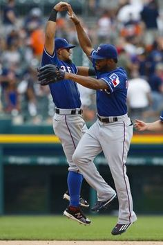 Aug 23, 2015; Detroit, MI, USA; Texas Rangers second baseman Rougned Odor (12) and center fielder Delino DeShields (7) celebrate after the game against the Detroit Tigers at Comerica Park. Texas won 4-2. Mandatory Credit: Rick Osentoski-USA TODAY Sports