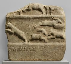Relief fragment, Imperial, 1st–2nd century a.d., Roman; found at Sardis.  The relief shows part of a scene of a venatio (a series of games in the theater or circus comprising fights between men and animals or between different types of animals). At the bottom is what remains of a Greek inscription, indicating that the scene represents the third day of the games.