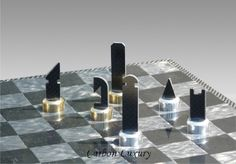 The Carbon Luxury Chess set. EUR 8,000 (source) High Quality steel feet, 24 carat gilded and sterling silvered. Made from high grade steel of some sort.