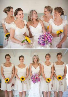 love the single sunflower bridesmaid bouquets.