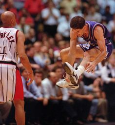 John Stockton leaps in the air after sinking a three-point shot a the buzzer to beat the Houston Rockets 103-100 Thursday, May 29, 1997, in Houston. The Rockets' Charles Barkley walks off the court at left. The Jazz advanced to The NBA Finals to play the Chicago Bulls. (Tribune file photo)