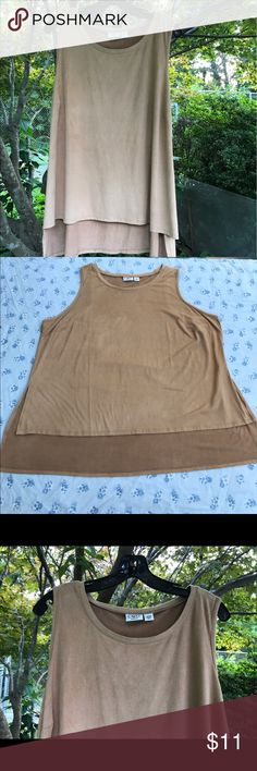 Cato Woman Tan Sleeveless High Low Tank Top 22/24W Cato Woman tan Sleeveless tank top is size 22/24W. Top's front is lower than the back. Top has a suede like feel to it. Because of the softness I purposely got it for my daughter at a 2nd hand place. But because of her sensitivities she couldn't handle the softness. Made in China of 88% polyester 12% spandex. Cato Tops Tank Tops