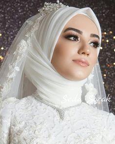 Image may contain: 1 person, close-up Hijabi Wedding, Wedding Hijab Styles, Wedding Robe, Muslimah Wedding Dress, Muslim Wedding Dresses, Muslim Brides, White Wedding Dresses, Designer Wedding Dresses, Bridal Dresses