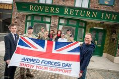 Stars of the long running UK television soap opera Coronation Street and troops showing their support for Armed Forces Day outside the famous Rovers Return pub.