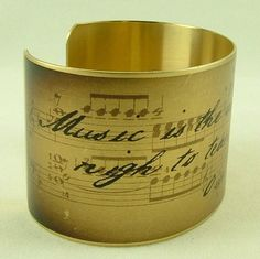 'Music is the art which is most nigh to tears and memories.' Oscar Wilde    Oscar Wilde Witty Quote - Music is the art - Sheet Music Brass Cuff. , via Etsy.