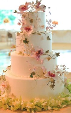 White Wedding Cake with Cascading Flowers & Vines. Very pretty.