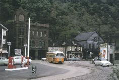 In this shot, Johnstown Traction 413 has turned from Franklin Street onto Valley Pike, en route to Ferndale. Johnstown was the smallest U. city to operate PCCs, which remained in service from 1947 until Johnstown Pennsylvania, Heaven On Earth, Historical Photos, Trains, Cities, The Past, Street View, Cars, History