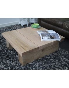 A 3 board square modern style coffee table in solid light/natural oak, but still retaining a rustic feeling and appearance.