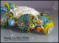Calypso - Goddess of the Seas - Art Glass Bracelet with lampwork beads and sterling silver by Michou Pascale Anderson by MichouJewelry on Etsy https://www.etsy.com/listing/174034102/calypso-goddess-of-the-seas-art-glass