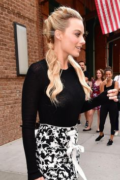 Margot Robbie sports loosely woven braids.
