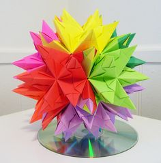 I think this paper art is so perfect! I can barley fold a piece of paper in half perfectly! All of the paper looks connected to each other by folds which seems difficult but looks perfect!