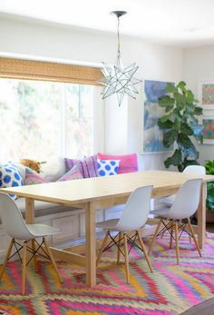 love the mix of fabrics. eclectic. dining room. kitchen banquette. home decor and interior decorating ideas.