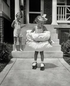 First Pair of Skates:  1936 Love the pillows tied around the little girl...:-)