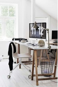 Modern Scandinavian office with wooden details and white interior