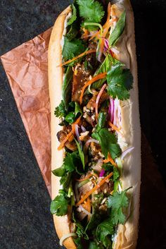 Fresh herbs, grilled chicken and crunchy vegetables come together for this sandwich.