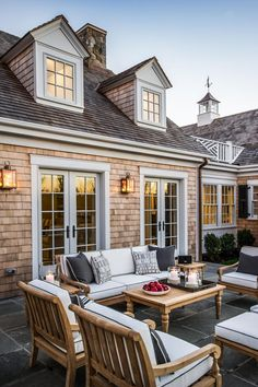 HGTV Dream Home patio with Ethan Allen patio furniture & copper lanterns