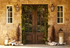 The front entry decorated for the holidays at an elegant Tennessee home