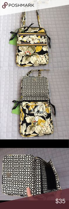 Vera Bradley Mini Hipster Bag Beautiful brand new Vera Bradley Mini Hipster bag in gorgeous retired Dogwood pattern. Pretty floral design lined with black and white pattern. Long, adjustable strap, front zip pocket, back large slit pocket. Front opens to reveal ID slot and inside contains 6 slots for credit cards and very secure inner zip pocket. Big zip pocket reveals larger area for more storage. Vera Bradley Bags Crossbody Bags