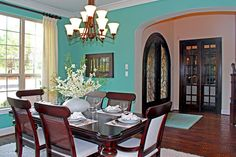 gorgeous Tiffany blue dining room walls with dark wood furniture.