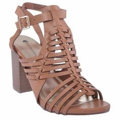 1757bbc00fcf A gladiator-inspired upper lends edgy flair to this strappy sandal built  atop a stacked heel for a boost of height.
