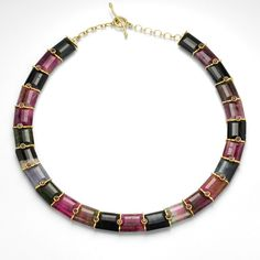 """An 18k yellow gold and watermelon tourmaline necklace with trapazoid shaped beads, and bezel set round burgundy sapphires = 3.36cttw.  Total length measures 18"""" - 18.25""""."""