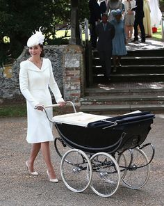 Catherine, Duchess of Cambridge pushes Princess Charlotte of Cambridge in her pram they leave the Church of St Mary Magdalene on the Sandringham Estate for the Christening of Princess Charlotte of Cambridge on July 5, 2015 in King's Lynn, England.