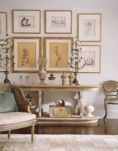 Under a grid of framed nudes in the living room, the long Tapestry Weavers table by BoBo holds her bibelots and found objects, including a pair of water-gilded finials from drapery rods.