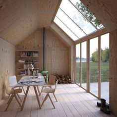 This archetypal Swedish building form, shaped like a Monopoly house, serves as an artist's studio, with a simple plywood interior and massive skylights to let in natural sunlight. Architecture + Photo by Waldemarson Berglund Arkitekter Tiny Homes, New Homes, Prefab Homes, Plywood Interior, Casas Containers, Interior Architecture, Interior Design, Simple Interior, Minimal Architecture