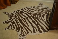 Step by step tutorial on how to make a rug from drop cloth in a zebra hide pattern