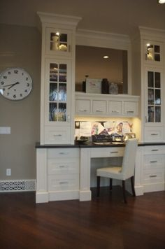 Lots to like here. Built-in lighting above work surface and in cabinets. Thick columns around drawers. Multi-depth hutch and drawers. Crown molded top. Gorgeous.