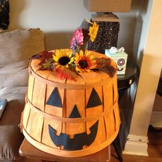 Bushel basket Pumpkin face ~ Use Craft Foam sheets for face parts ~ drill the correct size pc of wood from underneath for stem ~ decorate both sides of the top to use for month of Oct and Nov just simply turn around after Halloween