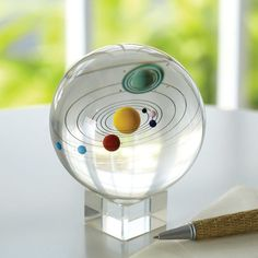Encased in a hand-blown, clear glass sphere: our entire solar system, planets and moons, from Mercury to Neptune. (Remember, Pluto no longer counts as a planet. Art Of Glass, Clear Glass, Marble Art, Glass Marbles, Glass Paperweights, Glass Ball, Crystal Ball, Clear Crystal, Paper Weights
