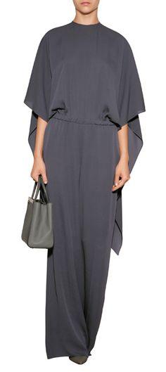 With a billowing drape and contemporary jumpsuit silhouette, this stunning one-piece from Valentino adds couture-worthy polish to evening looks #Stylebop
