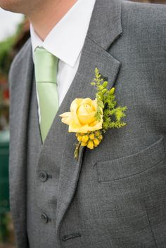 Steph & Ross' rustic vintage wedding. Yellow buttonholes.