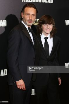 Andrew Lincoln and Chandler Riggs attend 'The Walking Dead' premiere at Madison Square Garden on October 9, 2015 in New York City.