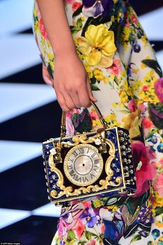 D&G - Milan Fashion Week - Clocks featured on box bags which could either have taken inspiration from Alice and Wonderland's white rabbit or perhaps even the striking of midnight in Cinderella. #fashion #style #milan fashion