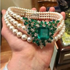 Very elegant vintage pearls and emeralds necklace. I have no idea about the brand