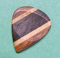 Custom wood guitar pick, They dont work as well and you would think.