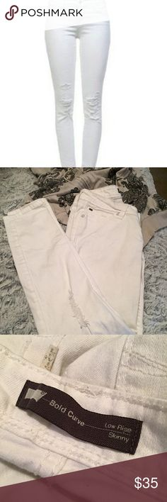 LEVI'S Bold Curve Skinny Jeans White Never worn but washed. These are the distressed low-rise bold curve skinny jeans in white. They have some pale pink marks on them (pictured) as if the sock monster tossed one in the laundry. Size: 29/32 Retail:$125 Price reflects sock monster aftermath. They're still darling casual jeans. Levi's Jeans Skinny