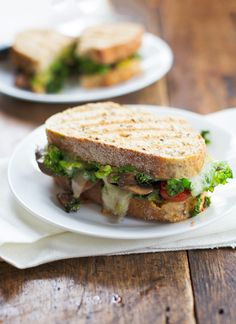 This avocado veggie panini is stuffed with lots of sauteed mushrooms, tomatoes, and kale, and smeared with avocado. So yummy! #vegetarian #healthy #cleaneating #recipe | pinchofyum.com
