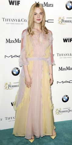 Elle Fanning's Red Carpet Style - In Valentino, 2015 from InStyle.com