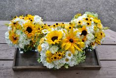 brown eyed susan and daisy wedding decor | The yellow and white color palette was carried through to the ...